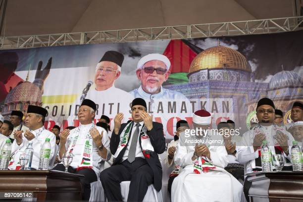 Malaysian Prime Minister Najib Razak prays during a demonstration against US President Donald Trumps announcement to recognize Jerusalem as the...