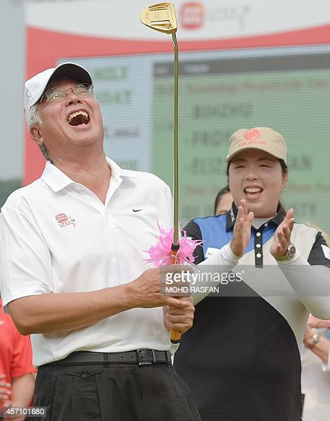 Malaysian Prime Minister Najib Razak reacts as Feng Shanshan of China applauds after a prize giving ceremony during the Sime Darby LPGA Malaysia 2014...