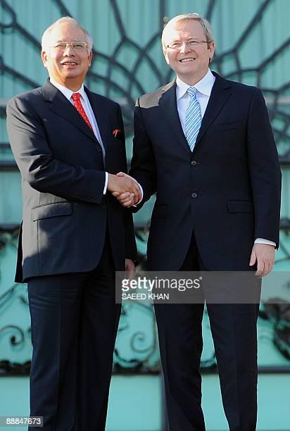 Malaysian Prime Minister Najib Razak receives his Australian counterpart Kevin Rudd at the prime minister's office in Malaysia's administrative...