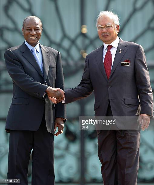 Malaysian Prime Minister Najib Razak shakes hands with Guinea's President Alpha Conde after an official welcome ceremony in Malaysia's administrative...