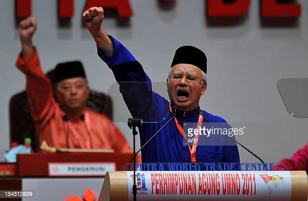 Malaysian Prime Minister Najib Razak shouts slogans at the end of his address to the ruling party's annual general assembly in Kuala Lumpur on...