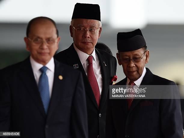 Malaysian Prime Minister Najib Razak watches as Myanmar's President Thein Sein and Malaysia's King Abdul Halim Mu'adzam Shah leave after a welcome...