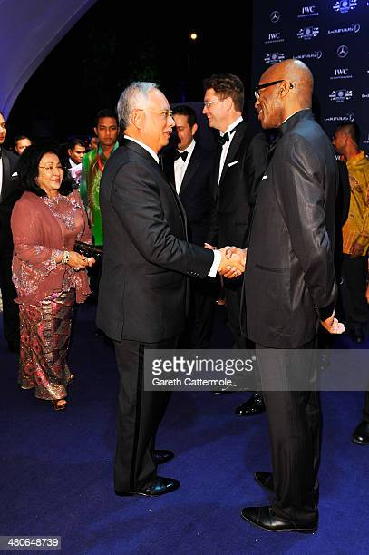 Malaysian prime minister Tun Abdul Razak shakes hands with Laureus Academy Chairman Edwin Moses attends the 2014 Laureus World Sports Awards at the...