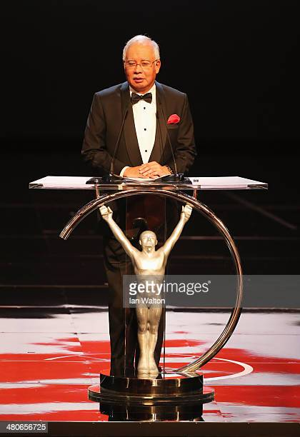 Malaysian prime minister Tun Abdul Razak speaks on stage during the 2014 Laureus World Sports Award show at the Istana Budaya Theatre on March 26...