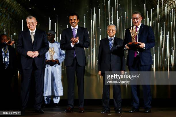 Malaysian Prime Minister Tun Dr Mahathir Mohamad and Emir of Qatar Sheikh Tamim Hamad AlThani pose for a photo during the Sheikh Tamim Hamad AlThani...