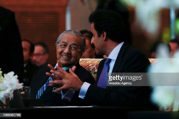 Malaysian Prime Minister Tun Dr Mahathir Mohamad talks to Emir of Qatar Sheikh Tamim Hamad AlThani during the Sheikh Tamim Hamad AlThani...