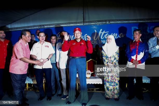 Malaysian Prime Minister Tun Mahathir Mohamad gestures as he attends Anwar Ibrahim's election campaign in Port Dickson Malaysia on October 8 2018 The...