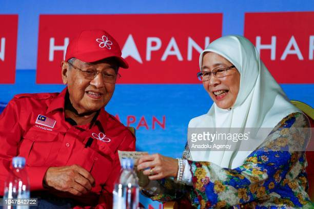 Malaysian Prime Minister Tun Mahathir Mohamad talks to his deputy Wan Azizah as they attend Anwar Ibrahim byelection campaign in Port Dickson...