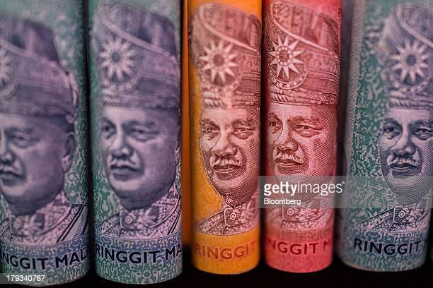Malaysian ringgit banknotes of various denominations are arranged for a photograph in Kuala Lumpur Malaysia on Monday Sept 2 2013 Malaysias ringgit...