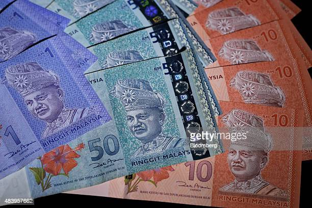 Malaysian ringgit banknotes of various denominations are arranged for a photograph in Tokyo Japan on Friday Aug 14 2015 Malaysia's ringgit plunged...