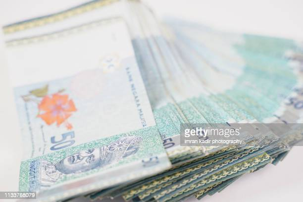 malaysian ringgit in close up - malaysian ringgit stock photos and pictures