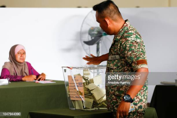 Malaysian Royal Army officer casts his ballot during early voting ahead of the Port Dickson Parliament byelection at Army Basic Training Centre in...