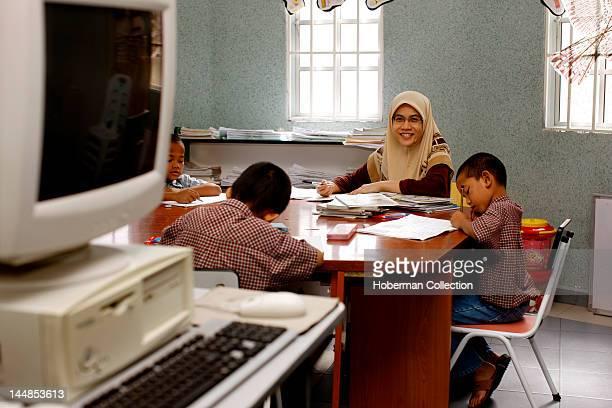 Malaysian Schoolteacher and Pupils