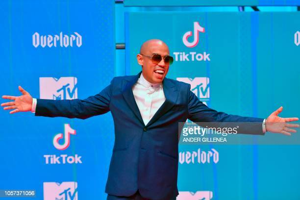 Malaysian singer Joe Flizzow poses on the red carpet ahead of the MTV Europe Music Awards at the Bizkaia Arena in the northern Spanish city of Bilbao...