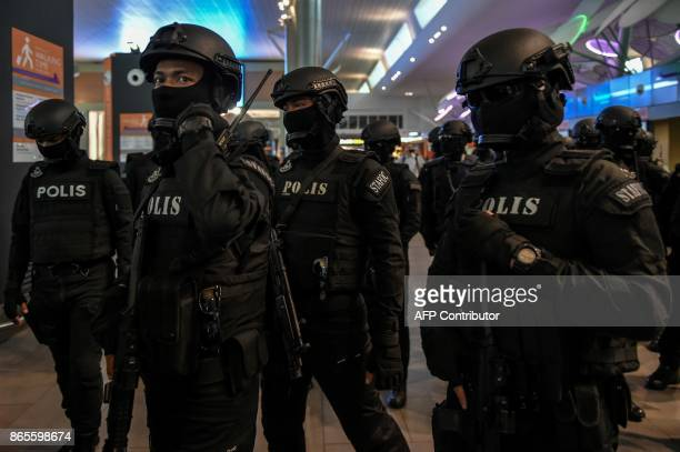 Malaysian Special Task Force On Organised Crime arrive to provide security at the lowcost carrier Kuala Lumpur International Airport 2 during a visit...