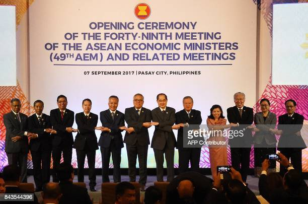 Malaysian Trade Minister Sri Mustapa Mohammed Myanmar's Minister of Planning and Finance Kyaw Win Philippine Undersecretary of Trade and Industry...
