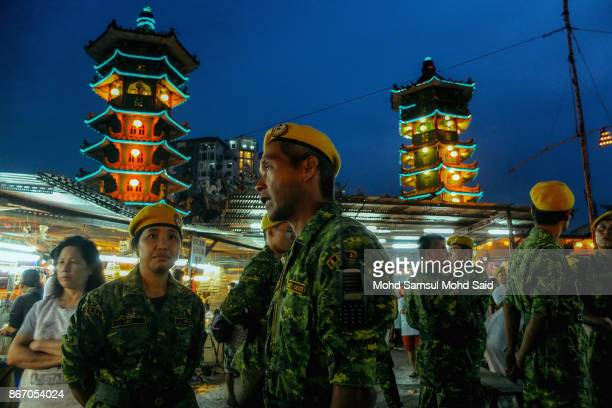 Malaysian volunteers deparment stand guide before chinese devotees start their prayers during The Nine Emperor Gods Festival inside the temple on...