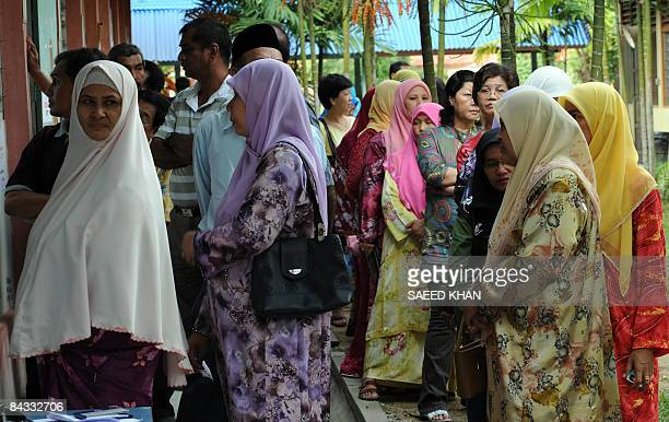 Malaysian voters wait for their turn at a polling station in northeastern Terengganu state on January 17 2009 Voting began in a hotly contested...
