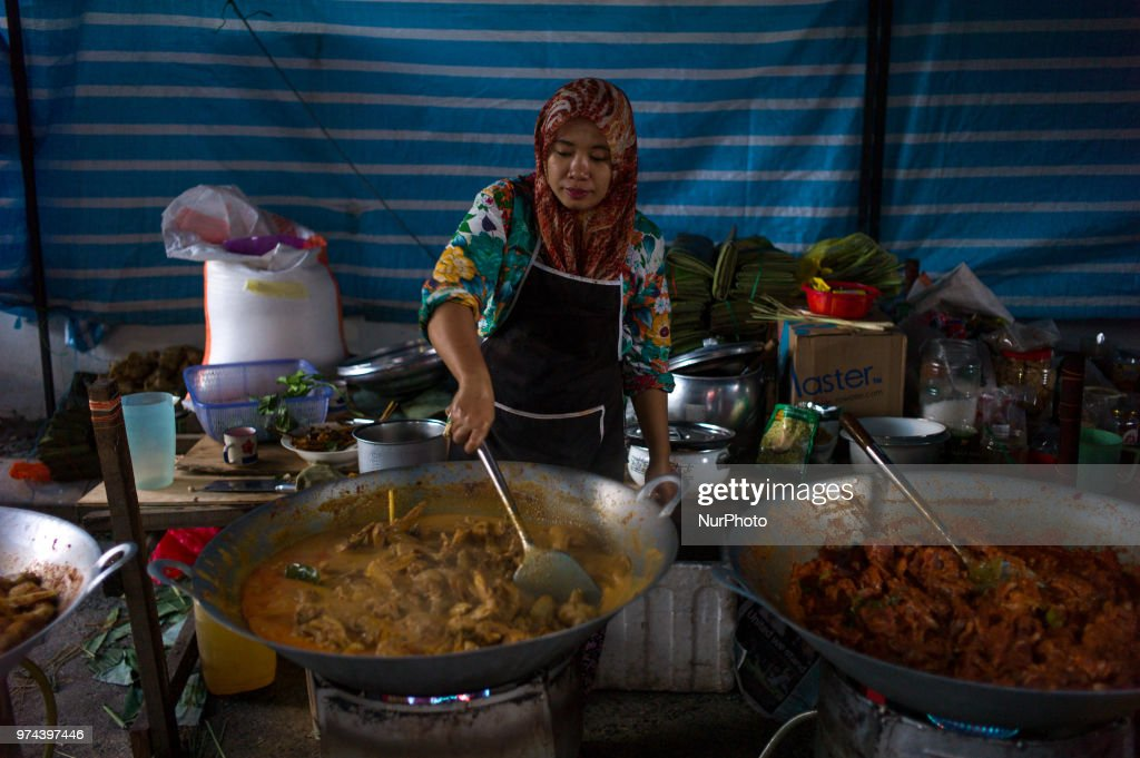 Malaysian woman prepares Rendang Chicken in Kuala Lumpur, Malaysia on June 14, 2018. Rendang is traditionally prepared by the Minangkabau community during festive occasions such as traditional ceremonies, wedding feasts and Eid al-Fitr. Eid al-Fitr is an important religious holiday celebrated by Muslims worldwide that marks the end of Ramadan, the Islamic holy month of fasting.