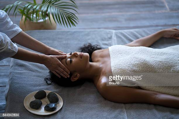 Malaysian woman receiving head massage at the spa.