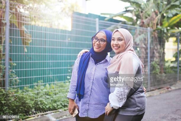 Malaysian women walking on the streets of Kuala Lumpur, Malaysia