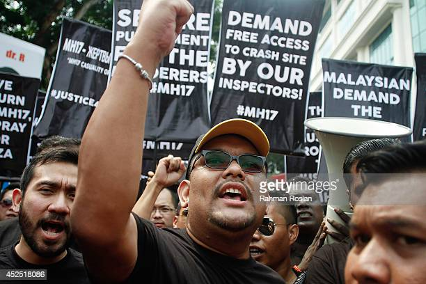 Malaysian youths protest against the downing of flight MH17 outside of Russian Federation embassy on July 22 2014 in Kuala Lumpur Malaysia Malaysia...