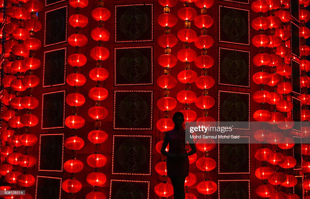 Malaysian-Chinese woman poses for a photogrph in front of the tallest outdoor Chinese lantern replica standing at 72-feet height decorated at Malaysia landmark KLCC ahead of Lunar New Year of the monkey celebrations outside Kuala Lumpur on February 3, 2016 in Kuala Lumpur, Malaysia. According to the Chinese Calendar, the Lunar New Year which falls on February 8 this year marks the Year of the Monkey, the Chinese Lunar New Year also known as the Spring Festival is celebrated from the first day of the first month of the lunar year and ends with Lantern Festival on the Fifteenth day.