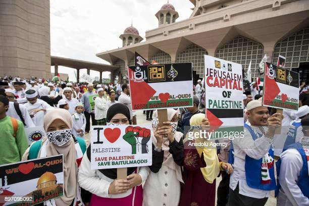 Malaysians hold banners during a demonstration against US President Donald Trumps announcement to recognize Jerusalem as the capital of Israel and...