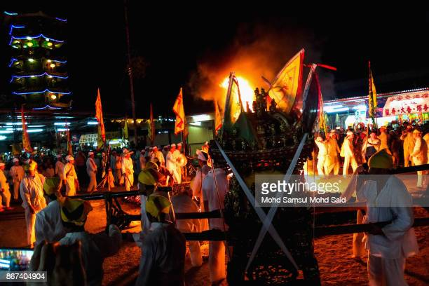 Malaysians of Chinese descent walk on burning charcoals during the last day of Chinese Nine Emperor Gods Festival inside the temple on October 28...