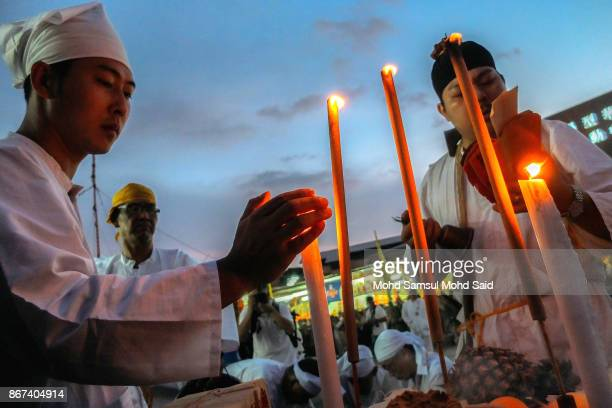 Malaysians of Chinese performs a specials prayer during the last day of Chinese Nine Emperor Gods Festival inside the temple on October 28 2017 in...