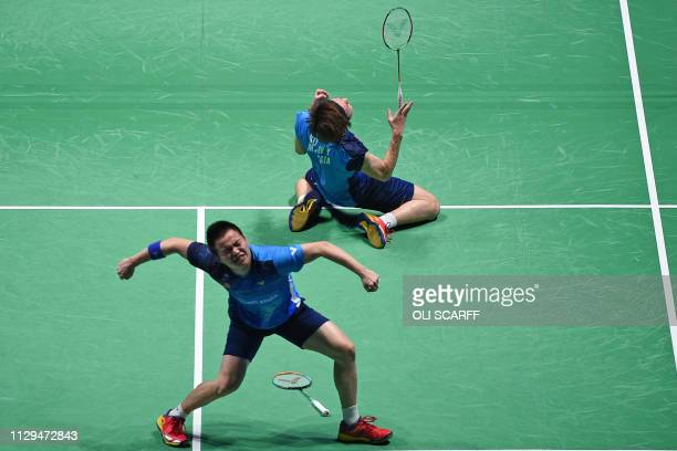 Malaysia's Aaron Chia celebrates with Soh Wooi Yik after beating Indonesia's Fajar Alfian and Muhammad Rian Ardianto in the mens doubles semi final...