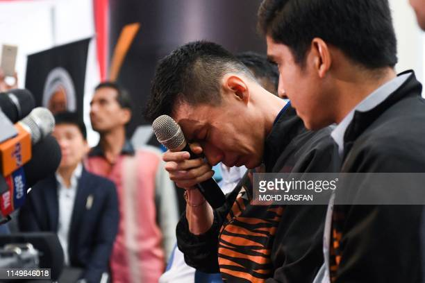 Malaysia's badminton player Lee Chong Wei reacts during a press conference to announce his retirement in Putrajaya on June 13, 2019. - Cancer-hit...