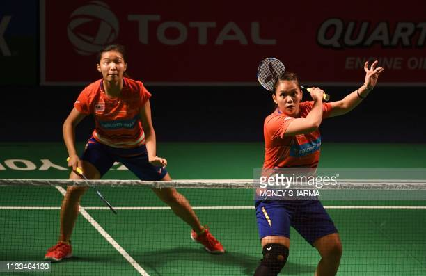 Malaysia's badminton players Mei Kuan Chow and Meng Yean Lee play a shot against Thailand's badminton players Phataimas Muenwong and Chayanit...