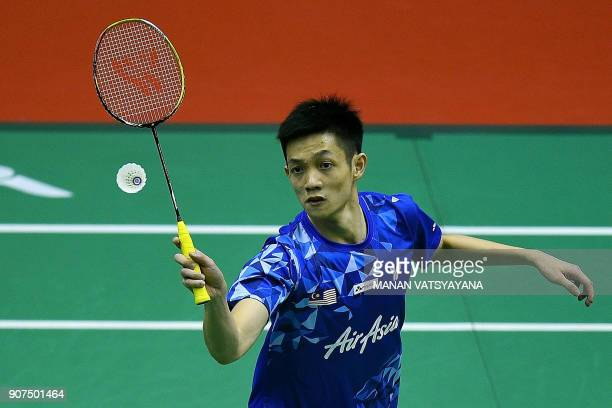 Malaysia's Daren Liew returns a shot against Denmark's Viktor Axelsen during their men's singles semifinal match at the 2018 Malaysia Masters...