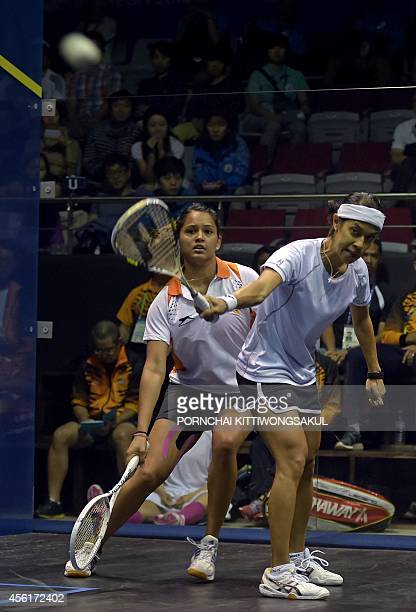 Malaysia's David Nicol Ann returns a shot against India's Pallikal Dipika Redecca during the squash team final round at the 2014 Asian Games in...