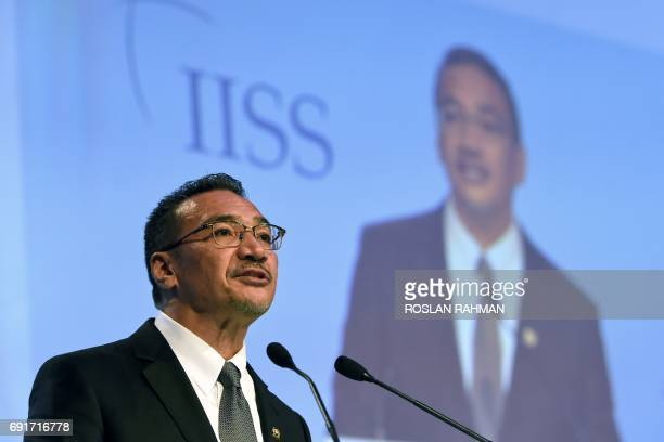 Malaysia's Defence Minister Hishammuddin Tun Hussein speaks during the third plenary session at the 16th Institute for Strategic Studies ShangriLa...