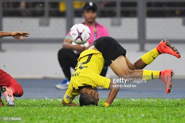 Malaysia's defender Nazirul Naim Che Hashim falls on the gournd during the AFF Suzuki Cup 2018 final football match between Malaysia and Vietnam at...