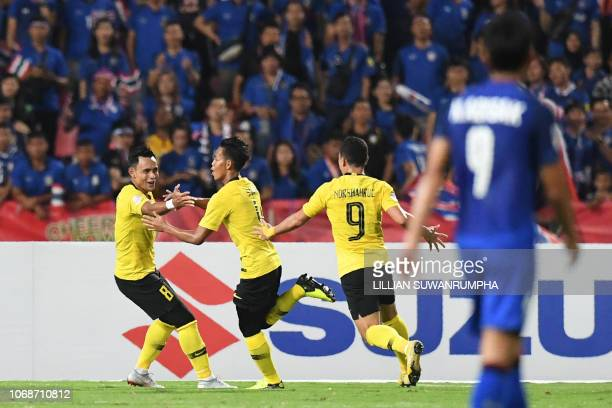Malaysia's defender Syahmi Safari celebrates with teammates after scoring a goal against Thailand during the second leg of the AFF Suzuki Cup 2018...