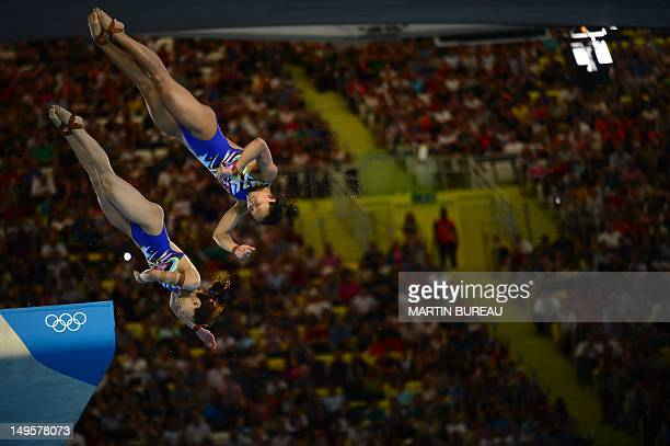 Malaysia's divers Pandelela Rinong Pamg and Mun Yee Leong compete in the women's synchronised 10m platform final diving event at the London 2012...