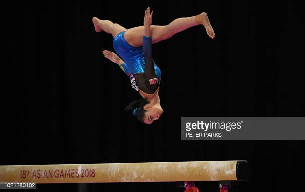 Malaysia's Farah Ann Abdul Hadi participates on the beam in the women's team final of the artistic gymnastics event during the 2018 Asian Games in...