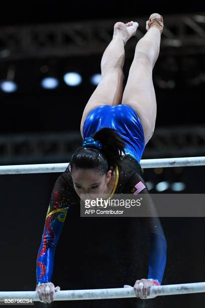 Malaysia's Farah Ann binti Abdul Hadi competes in the uneven bars during the women's artistic gymnastics competition of the 29th Southeast Asian...