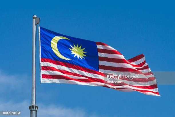 "malaysia's flag  namely ""jalur gemilang"" for malaysian waving over cloudy day in kuala lumpur - shaifulzamri bildbanksfoton och bilder"