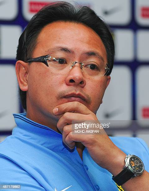 Malaysia's football interim coach Ong Kim Swee listens during a press conference at the Football Association of Malaysia headquaters in Kelana Jaya...