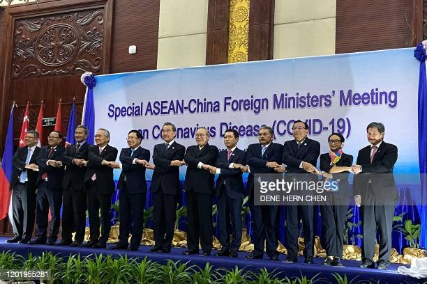 Malaysia's Foreign Minister Saifuddin Abdullah Myanmar's Union Minister for International Cooperation Kyaw Tin Singapore's Foreign Minister Vivian...