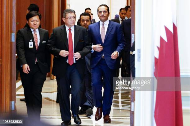Malaysia's Foreign Minister Saifudin Abdullah and Qatar's Foreign Minister Sheikh Mohammed bin Abdulrahman bin Jassim Al Thani arrive to hold a joint...
