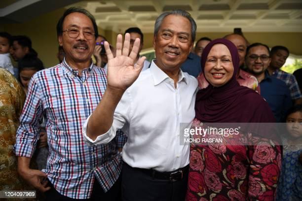 Malaysia's former interior minister Muhyiddin Yassin , his wife Noraini Abdul Rahman talk to the press outside his home in Kuala Lumpur on February...