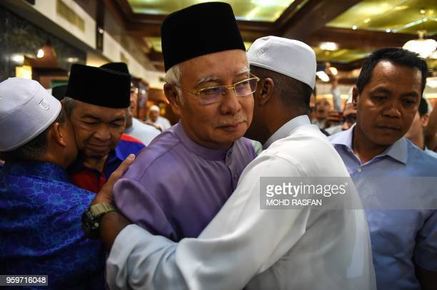 Malaysia's former prime minister Najib Razak and former deputy prime minister Ahmad Zahid Hamidi are greeted by supporters after Friday prayers at...