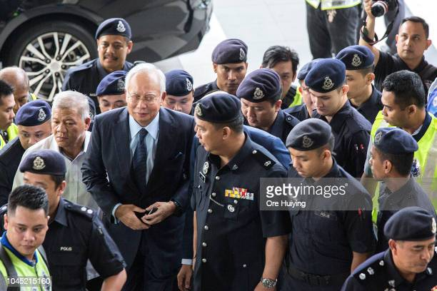 Malaysia's former Prime Minister Najib Razak arrives in Kuala Lumpur High Court on October 4 2018 in Kuala Lumpur Malaysia Najib's wife Rosmah Mansor...