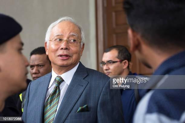 Malaysia's former Prime Minister Najib Razak exits the Kuala Lumpur High Court on August 8 2018 in Kuala Lumpur Malaysia Malaysia's former Prime...