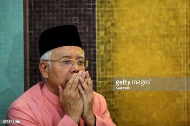 Malaysias former Prime Minister Najib Razak prays during attends the United Malays National Organisation 72th anniversary in Kuala Lumpur Malaysia on...